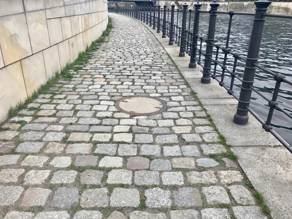 electric skateboard on cobblestone roads