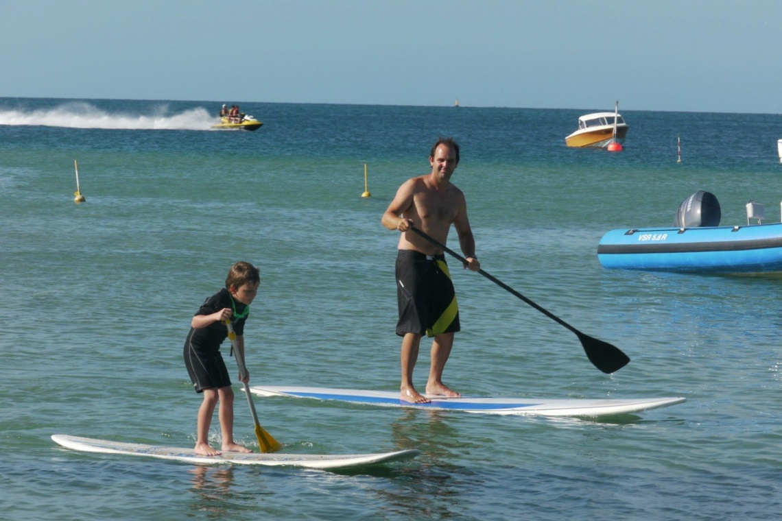 Paddle boarding with son Leo, who came up with the name 'Fliteboard